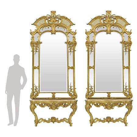 French early 19th century Louis XV st. giltwood and marble consoles with their original mirrors