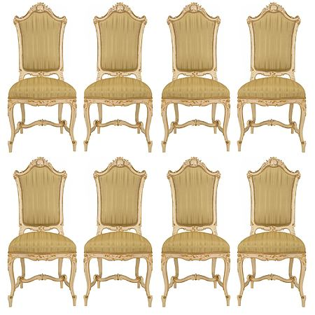 A set of eight Italian 19th century patinated and giltwood Venetian dining chairs