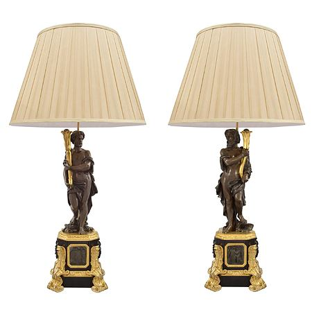 A pair of French 19th century Renaissance st. patinated bronze and ormolu lamps