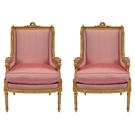 A pair of French 19th century Louis XVI st. giltwood armchairs