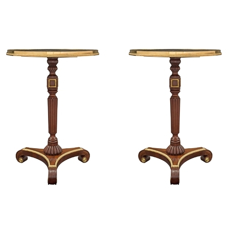 A pair of English 19th century Regency st. mahogany, ormolu, giltwood and Noir St. Laurent marble side tables