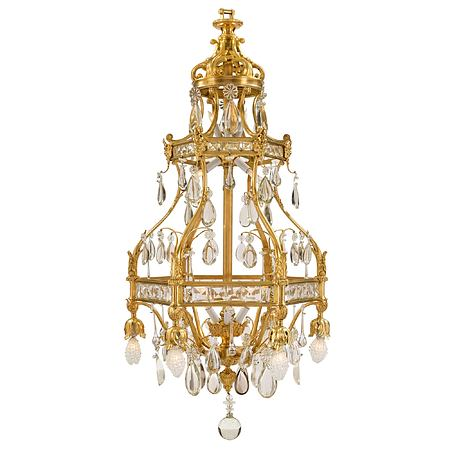 A French 19th century Louis XV st. ormolu and Baccarat crystal eighteen light chandelier