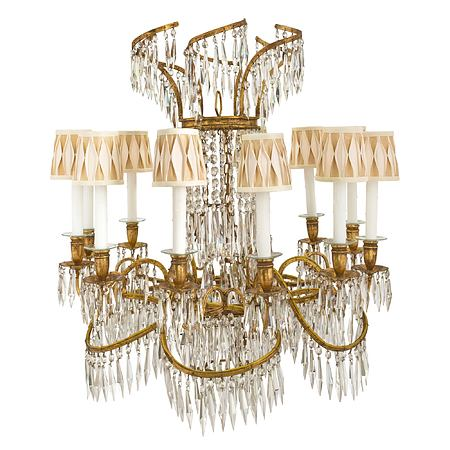 A Baltic 19th century Neo-Classical st. gilt iron and crystal, twelve light chandelier