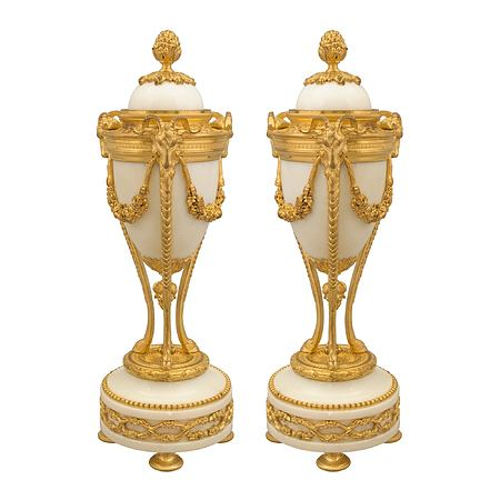 A pair of French 19th century Louis XVI st. white Carrara marble and ormolu Cassolettes