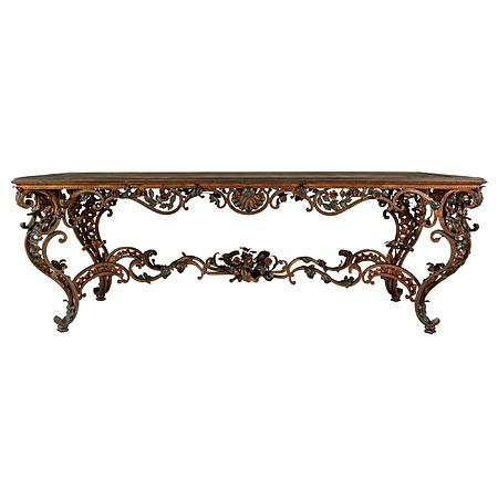 An Italian mid 19th century Louis XV st. patinated wrought iron and marble center table