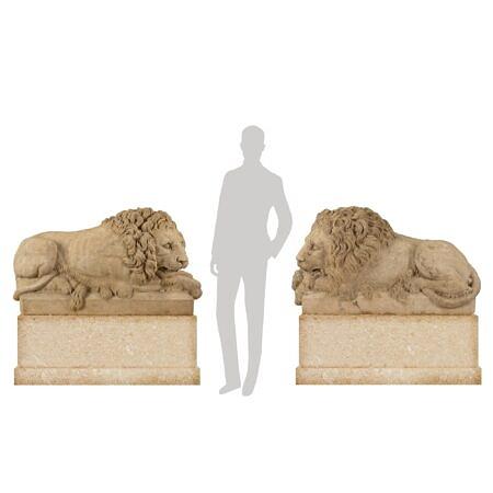 A true pair of Italian 18th century Louis XVI period white Carrara marble lions
