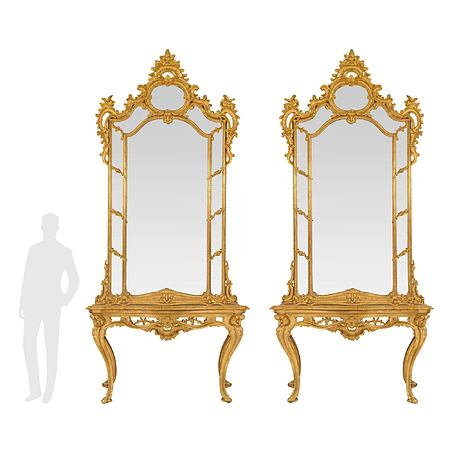 A pair of Italian 18th century Louis XV period giltwood and marble Neapolitan consoles with their original mirrors