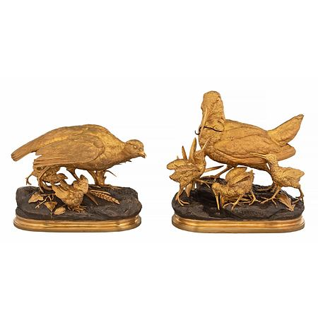 A pair of French Louis XVI st. patinated bronze and ormolu statues, signed Alfred Dubucand