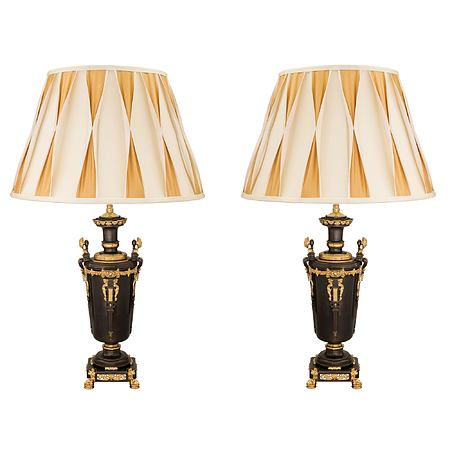 A pair of French mid 19th century Renaissance st. patinated bronze and ormolu lamps