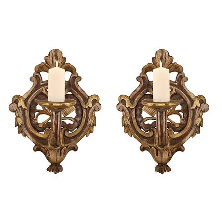 A pair of Italian 18th century Baroque period polychrome and mecca pierced one arm sconces
