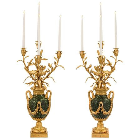 A pair of French 19th century Louis XVI st. ormolu and green Porphyry, four arm candelabras