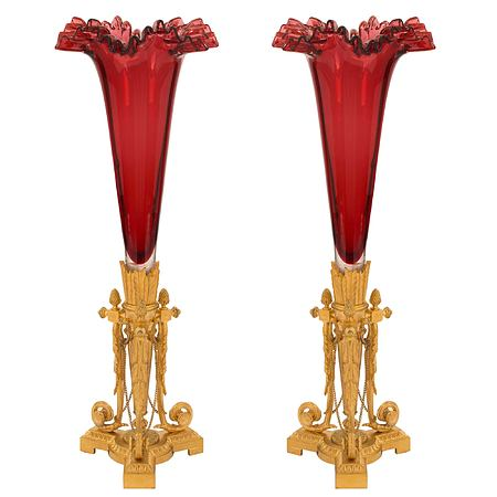 French 19th century Louis XVI st. oxblood red glass and ormolu vases