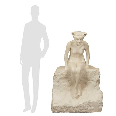 An Italian 19th century white Carrara marble statue of a maiden sitting on a rock