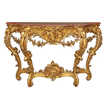 A French 19h century Louis XV st. giltwood console with the original marble top