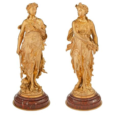 A pair of French 19th century Louis XVI st. Belle Époque period ormolu and rouge Griotte statues