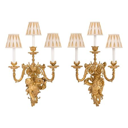 A pair of French 19th century Louis XVI st., Belle Époque period, ormolu sconces, attributed to Dasson