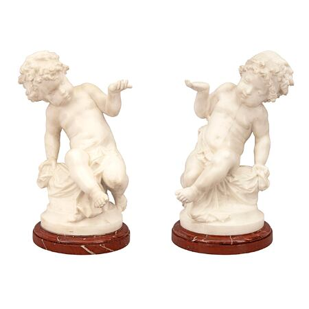 A pair of French 19th century Louis XVI st. white Carrara marble statues, signed Carrier Belleuse