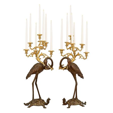 A pair of French 19th century patinated bronze and ormolu candelabras