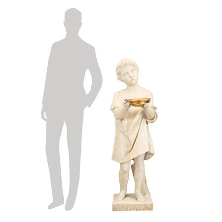An Italian 19th century white Carrara marble statue of a young boy with gilt accents