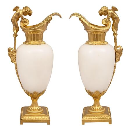 A pair of French 19th century Louis XVI st. Carrara marble and ormolu ewers, attributed to Henry Dasson