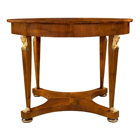 An Italian 19th century Neo-Classical walnut, ebonized Fruitwood, ormolu and giltwood center table from Lucca