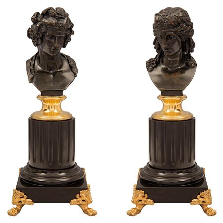 A true pair of French 19th century Louis XVI st. bronze, ormolu and Black Belgian marble statuettes of Apollo and Daphne.