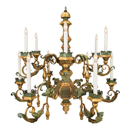 An Italian 18th Century Tuscan twelve light patinated tole, giltwood and gilt iron chandelier