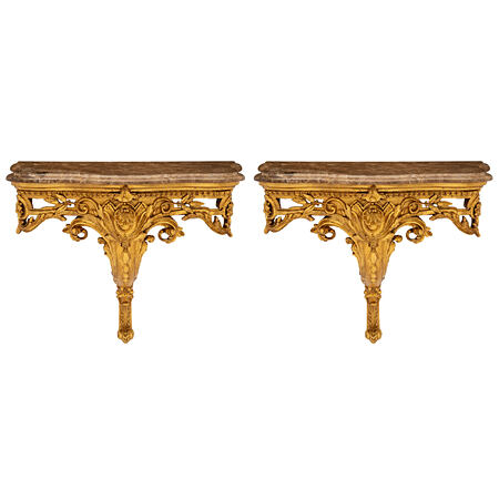 An identical pair of French 19th century Louis XV st. giltwood consoles/wall brackets