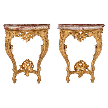 A true pair of French 19th century Louis XV st. giltwood consoles