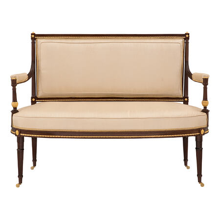 A French mid 19th century Louis XVI st. solid mahogany and ormolu mounted settee