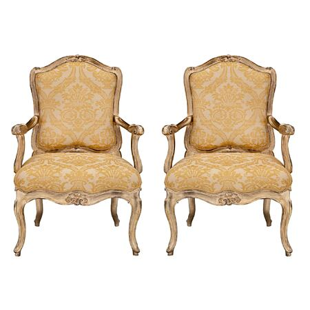 A pair of Italian 18th century Louis XV st. silvered leaf Venetian armchairs