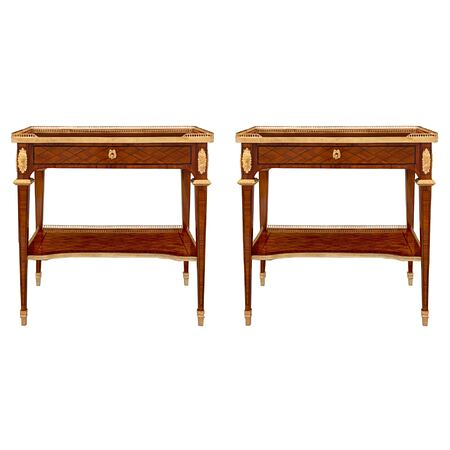 A pair of French 19th century Louis XVI st. kingwood, ebonized fruitwood and ormolu side tables