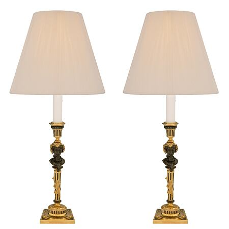 A pair of French 19th century Louis XVI st. ormolu and patinated bronze electrified candlestick lamps