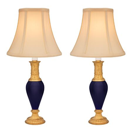 A pair of French 19th century Louis XVI st. cobalt blue porcelain and ormolu lamps