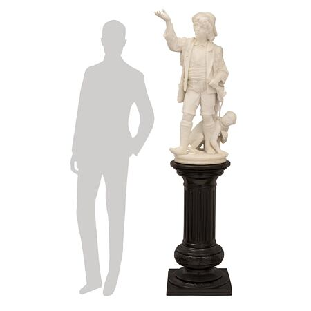 An Italian 19th century white Carrara marble statue of a charming street performer and his pet monkey