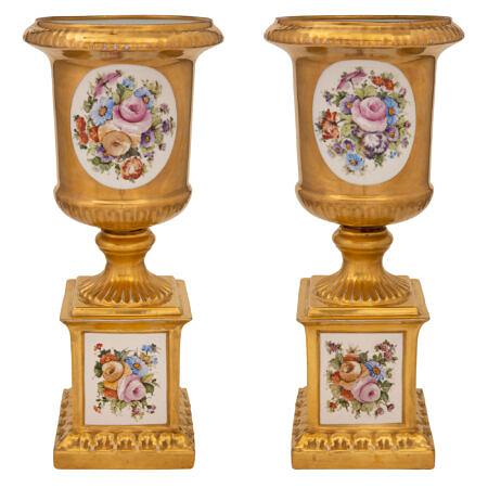 A pair of Italian 19th century Louis XVI st. Capodimonte porcelain urns