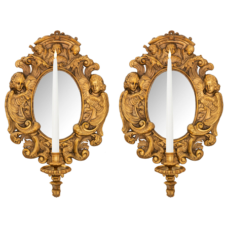 A pair of French 19th century Baroque st. ormolu mirrored sconces