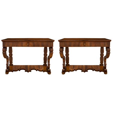 A pair of Italian 19th century Charles X st. walnut, maple wood and ormolu consoles